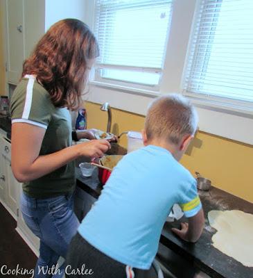 Chloe and Little Dude working on making cajeta empanadas