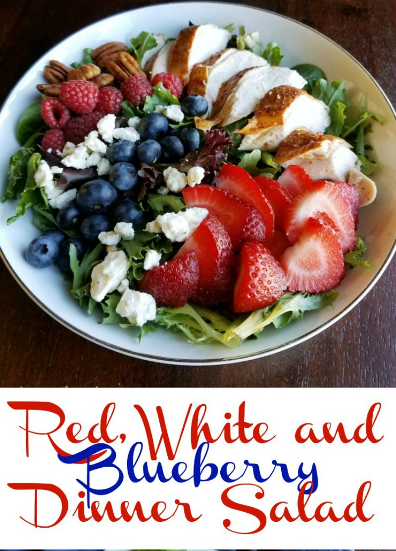 This dinner salad is perfect for Memorial Day, the 4th or July or any day! It is full of berries, cheese, greens, and chicken.  There is also a homemade dressing recipe if you'd like!