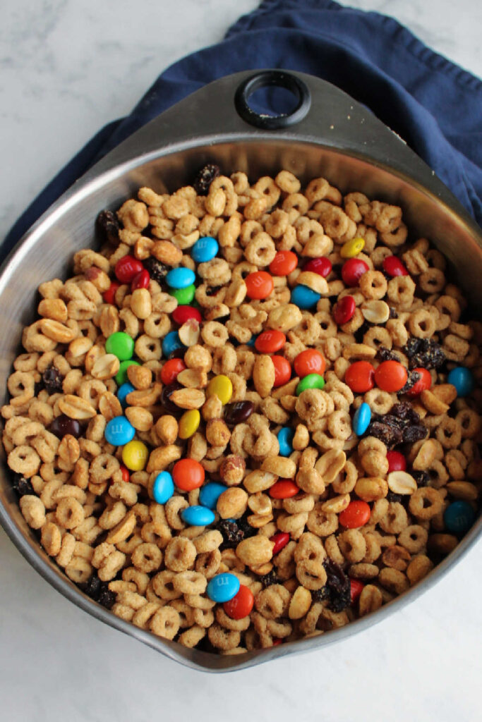Giant storage bowl filled with trail mix style cereal snack mix.