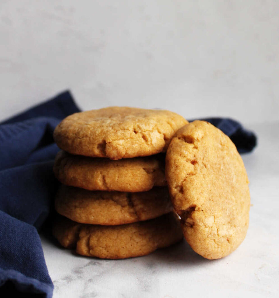 Stack of thick chewy maple cinnamon cookies.