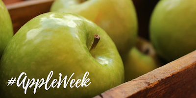 appleweek logo over green apples