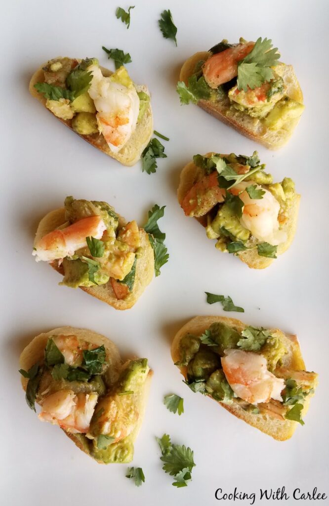 shrimp and avocado toast appetizers on platter.