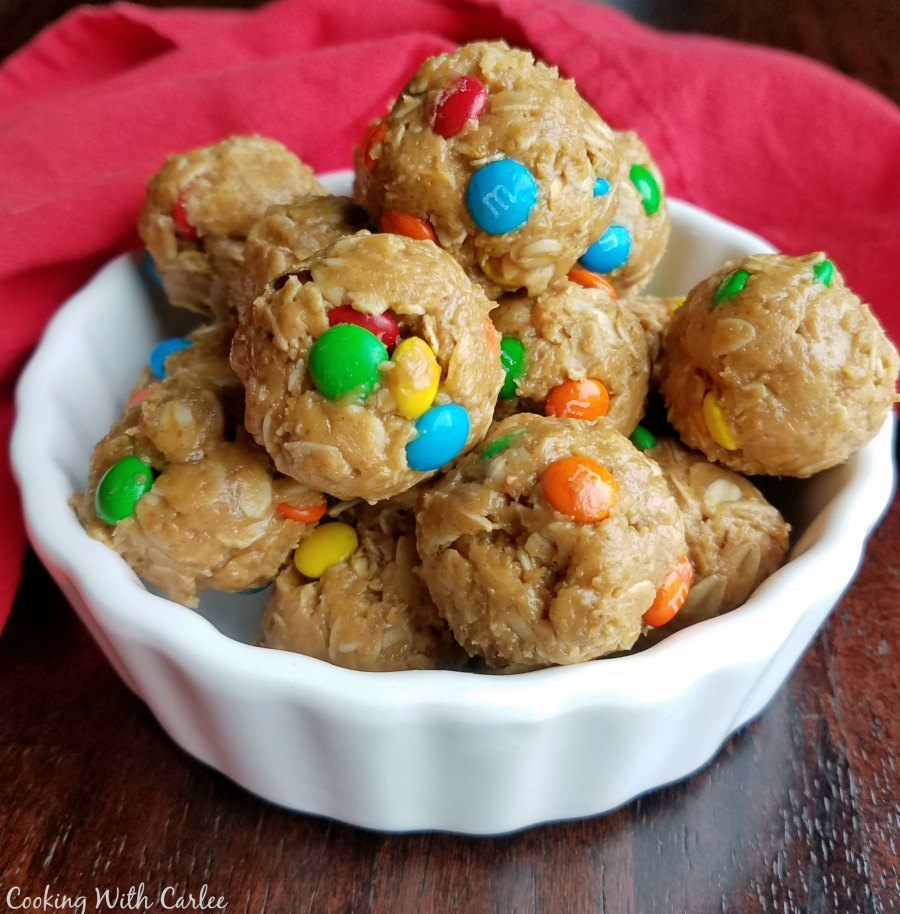 bowl full of monster cookie dough balls with mini M&Ms