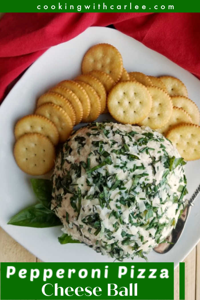 This cheese ball is the perfect party food.  It is easy to make, can be made ahead and tastes like pizza.  So many things to love!!  It is great for game day, an open house and more. It tastes amazing and people will enjoy it.