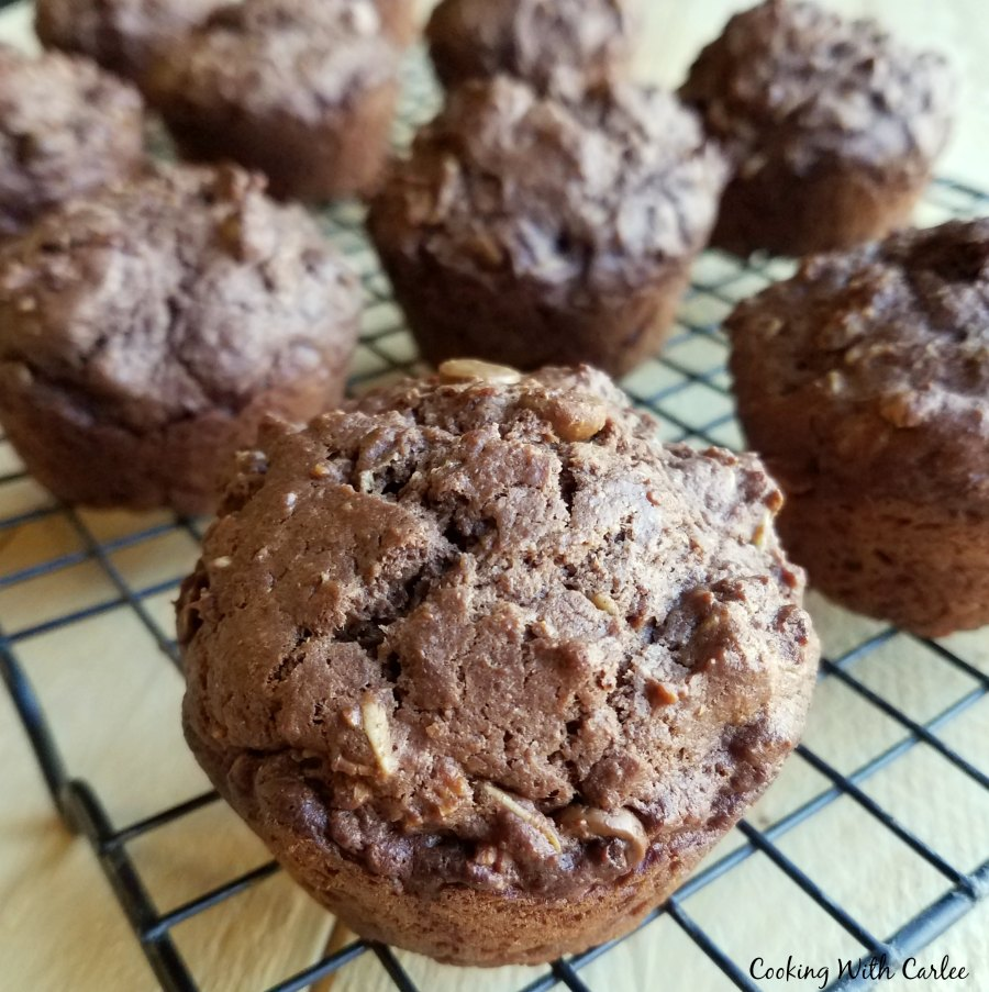 chocolate peanut butter sourdough muffins in wire cooling rack