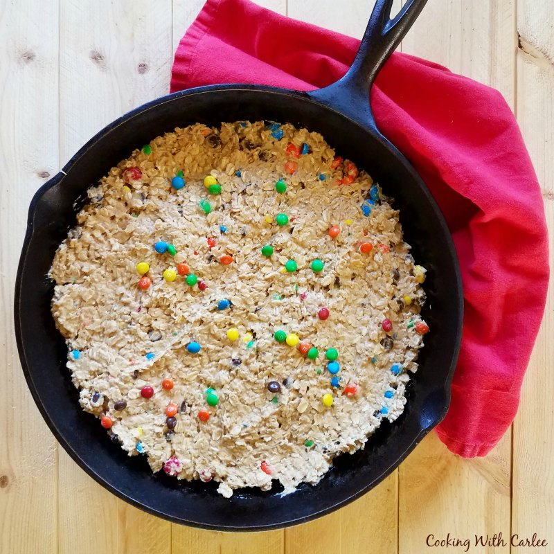 monster cookie dough pressed into skillet and ready to bake.