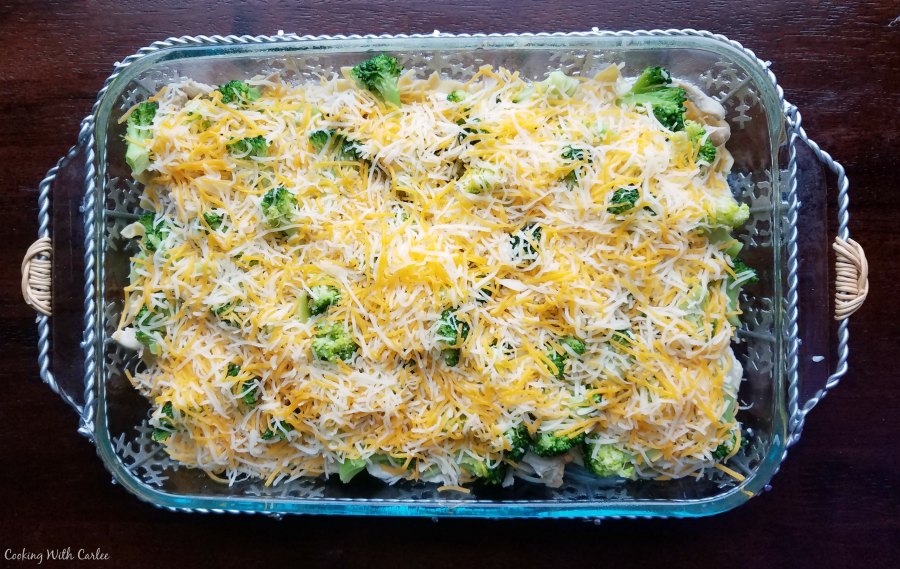 9x13 pan loaded with pasta, chicken, eggs and cheese ready to bake into a casserole