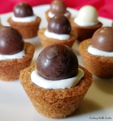 close up of cookie cups filled with marshmallow fluff and a truffle