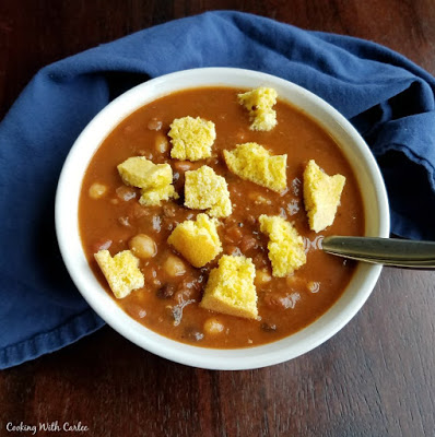 chunks of cornbread sprinkled over a bowl of chili