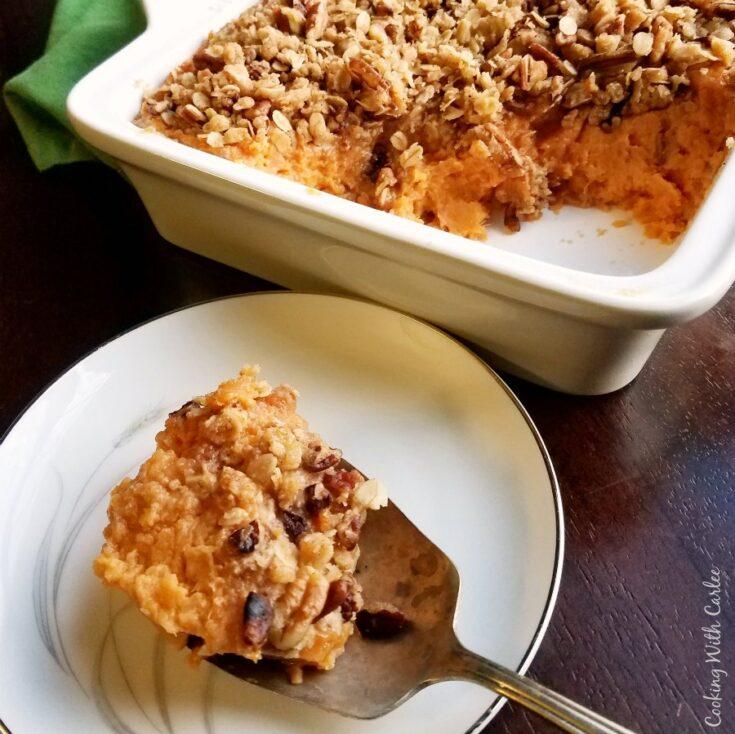 serving spoon full of sweet potato bake.