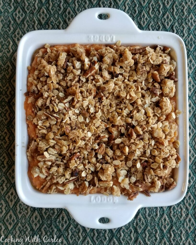 square casserole dish pile high with oatmeal and pecan crunch topping showing.