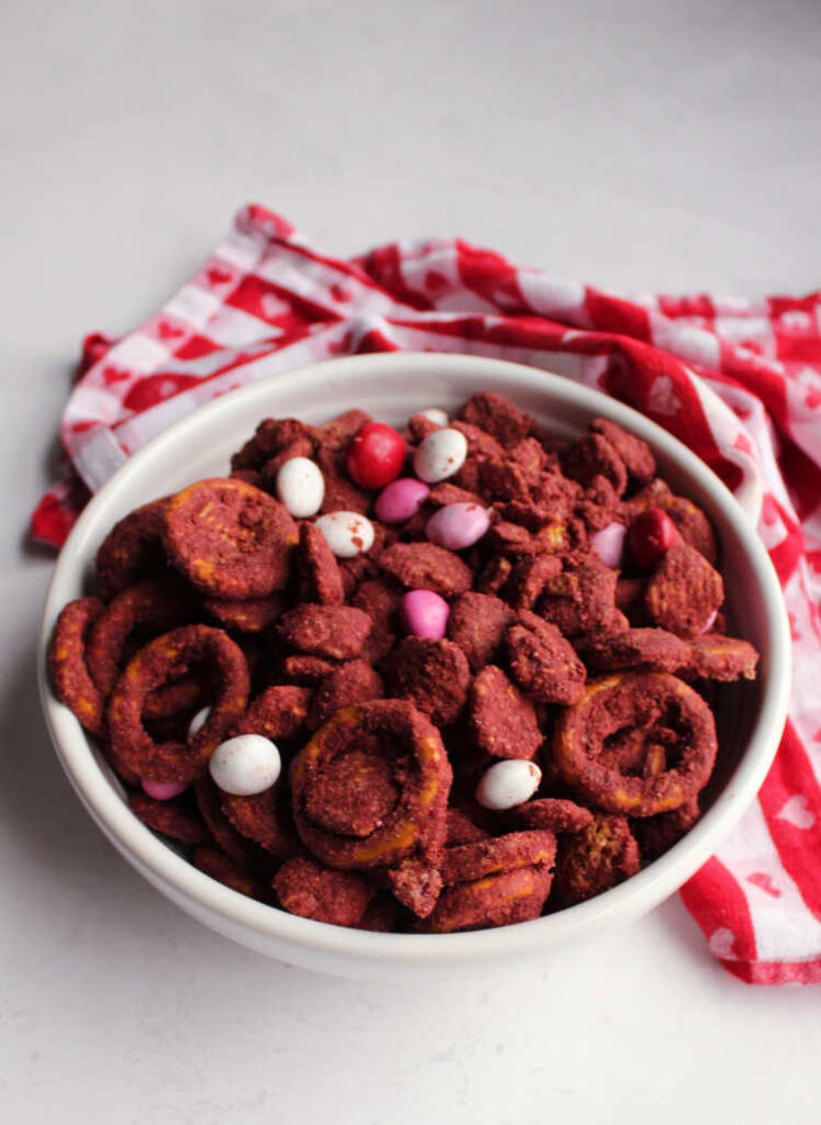 bowl of red velvet puppy chow ready for snacking
