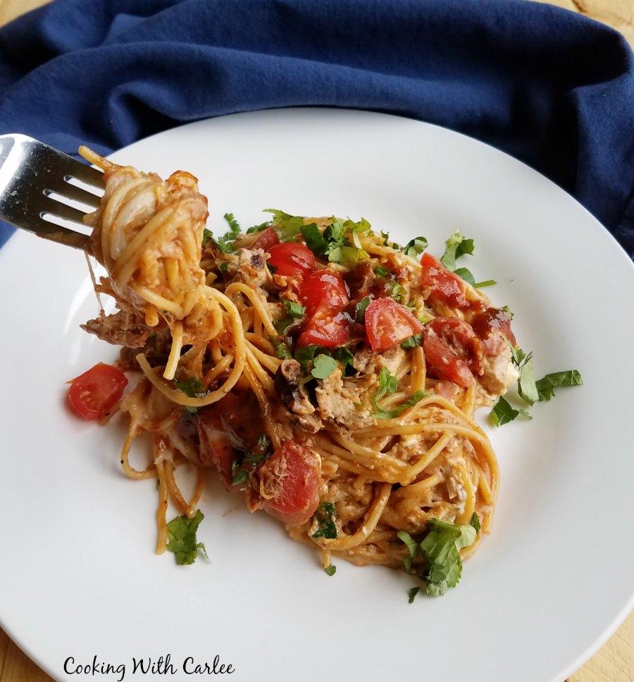 fork with twirled creamy bbq pulled pork spaghetti on it.