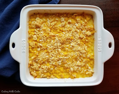 square casserole dish of scalloped corn fresh from the oven