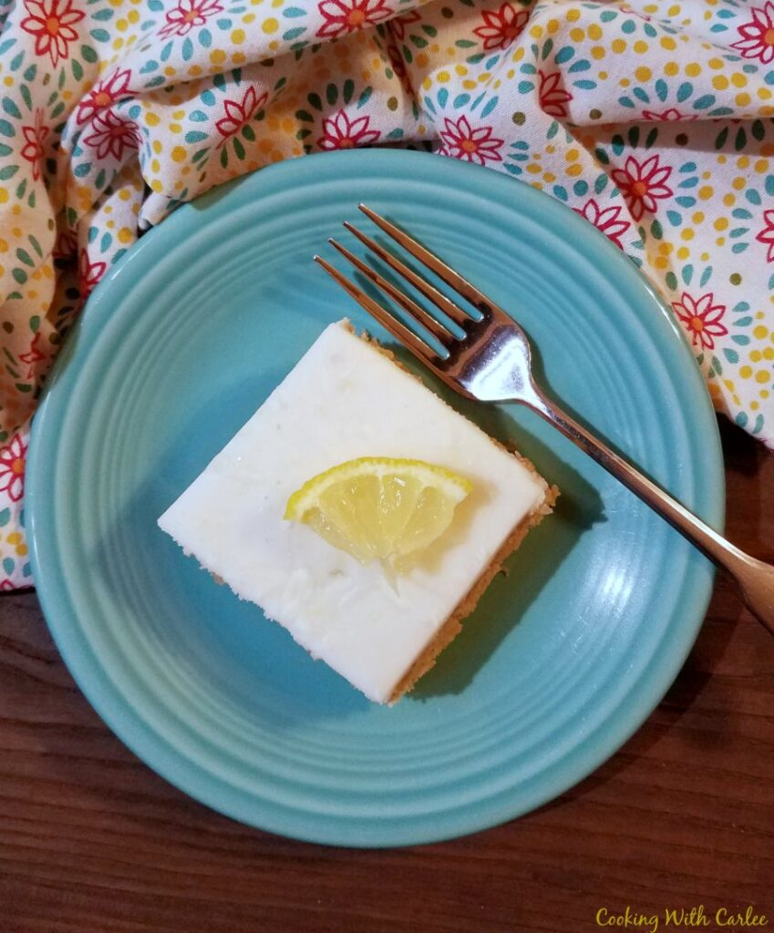 slice of arnold palmer cake with wedge of lemon on top.