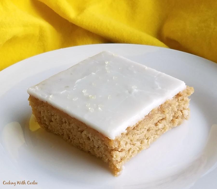 slice of tea and lemon sheet cake on plate