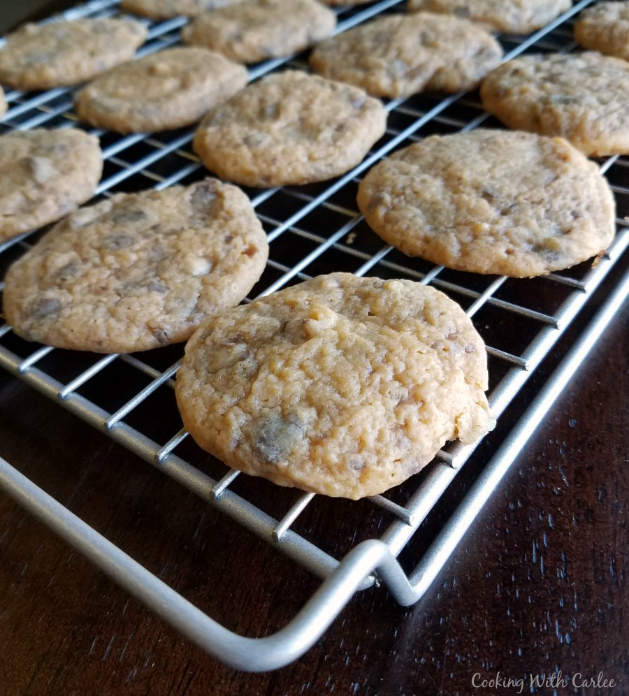 Butterscotch toffee cookies cooling on wire rack.