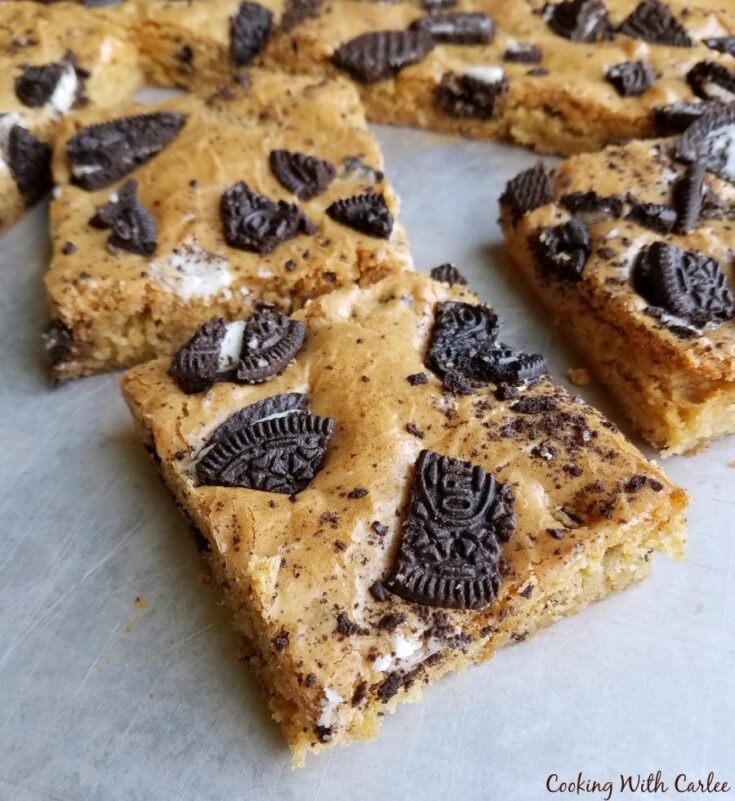pieces of cookies and cream blondie cut and ready to eat.