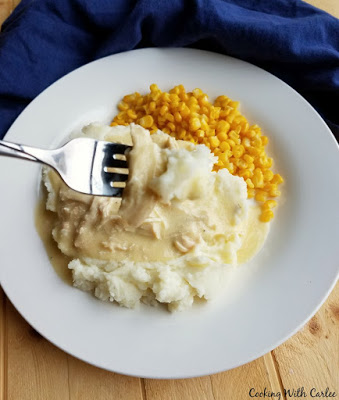forkful of chicken and gravy with mashed potatoes