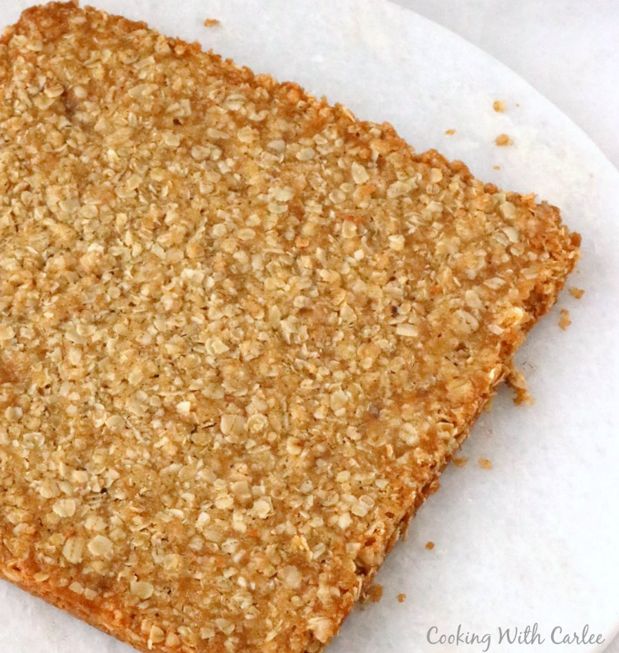 oatmeal bars dumped out of the pan, ready to be cut into bars.