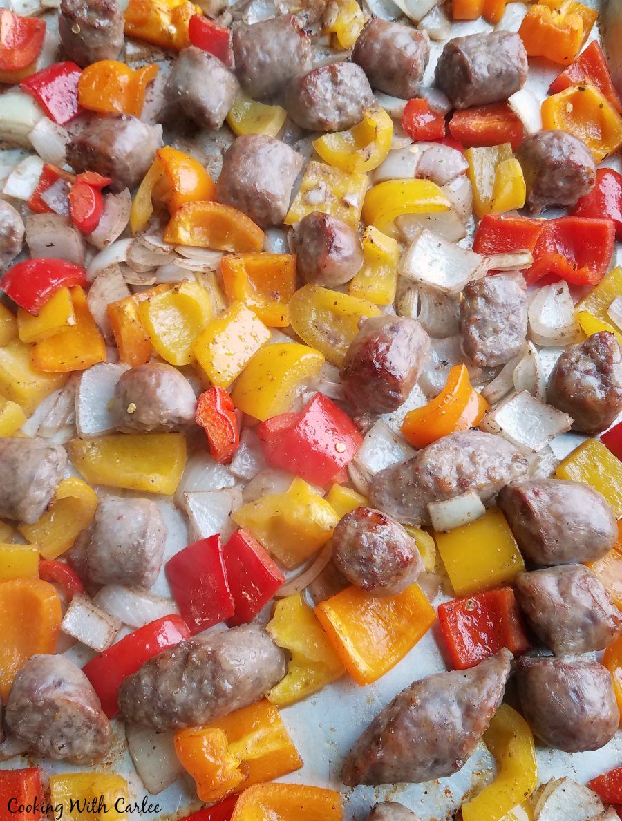 sheet pan loaded with italian sausage, colorful peppers and onions fresh from the oven.