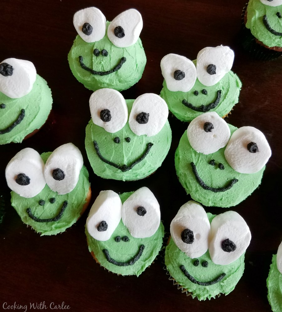 Cupcakes decorated like frogs with marshmallow eyes.