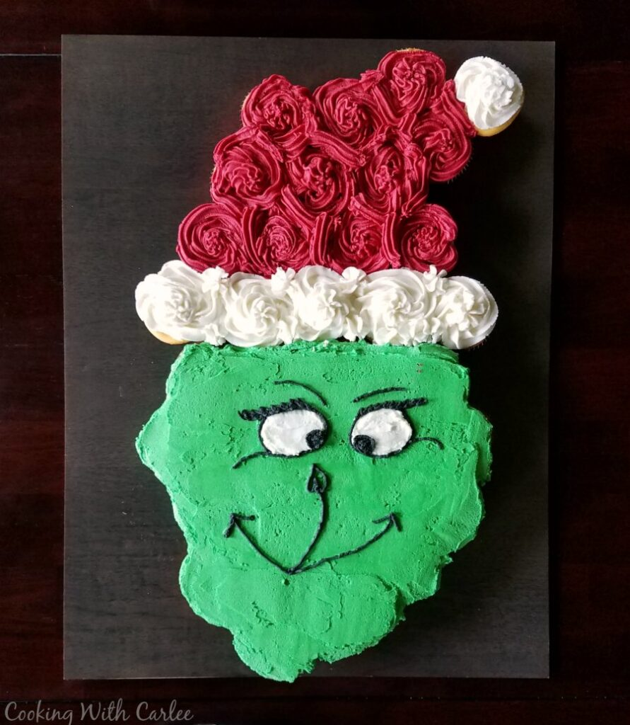 Grinch cupcake pull-apart cake with Santa hat for Dr. Seuss party.