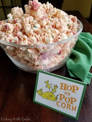 big bowl of popcorn next to sign that says hop on pop
