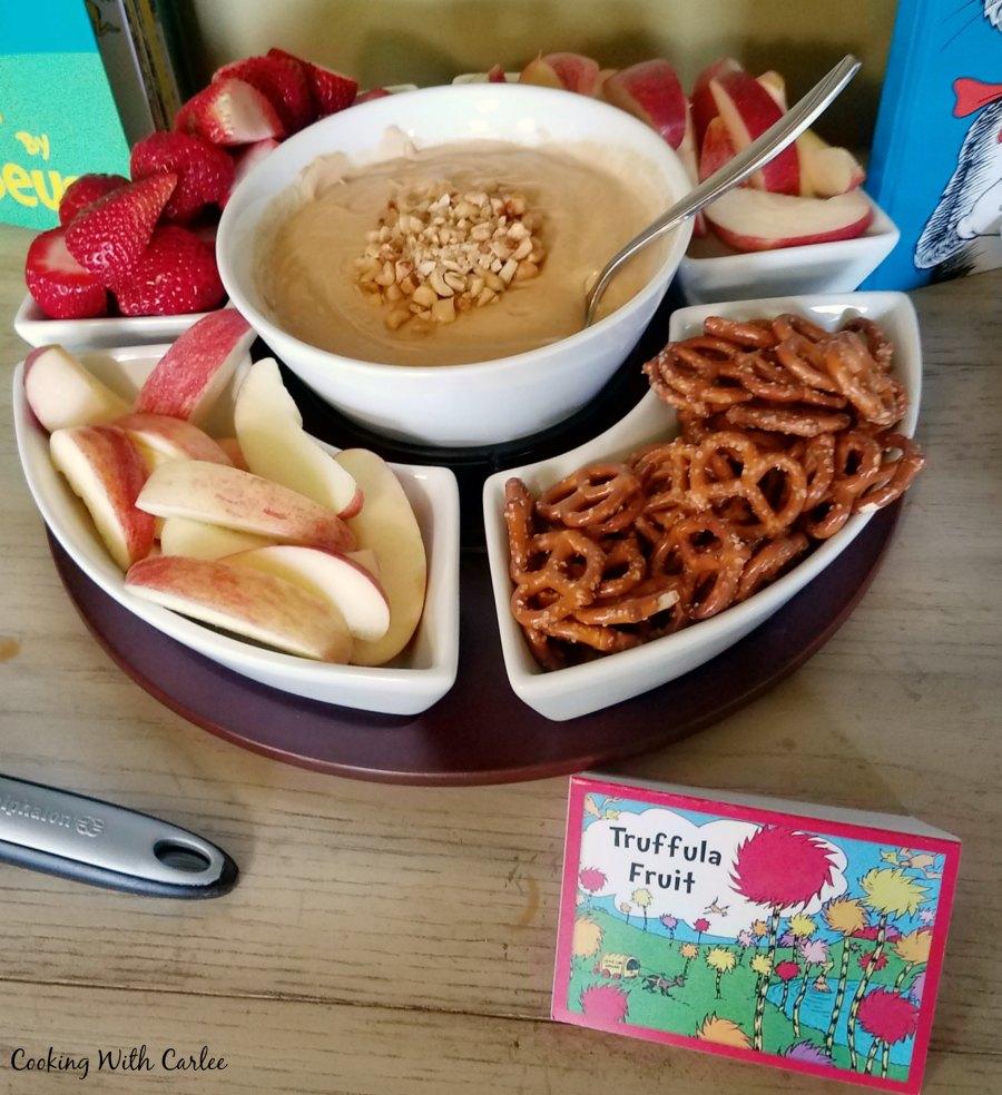 Chip and dip set filled with fruit, pretzels and peanut butter yogurt dip.