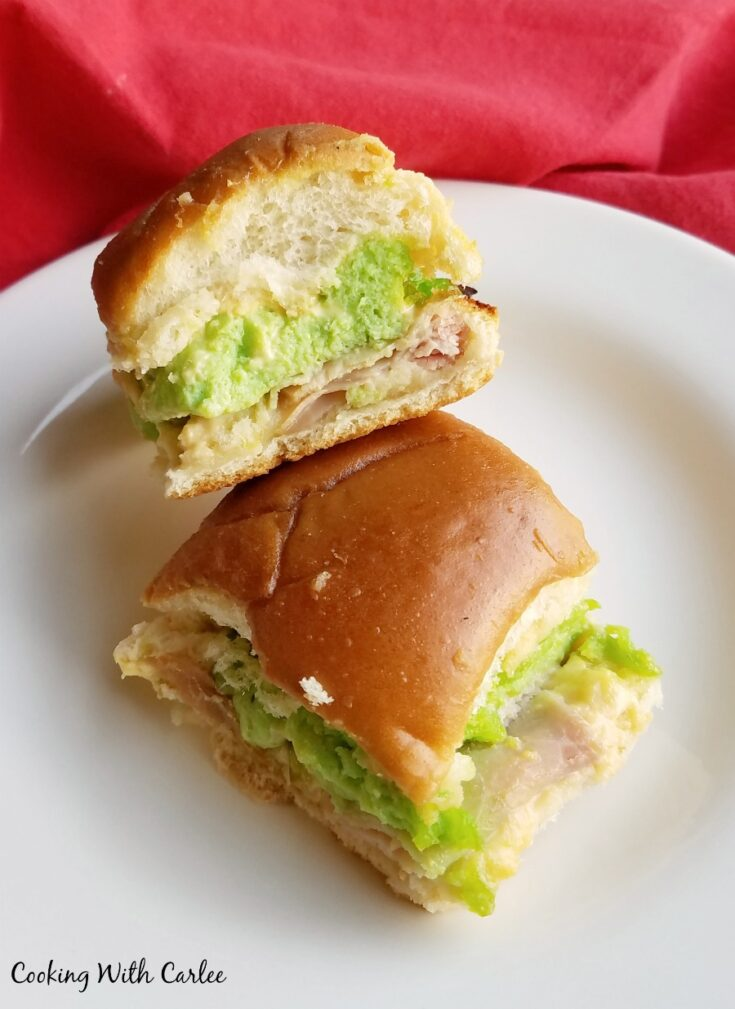 A couple of green eggs and ham sliders on plate ready to eat.