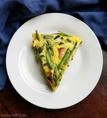 large slice of frittata on white plate