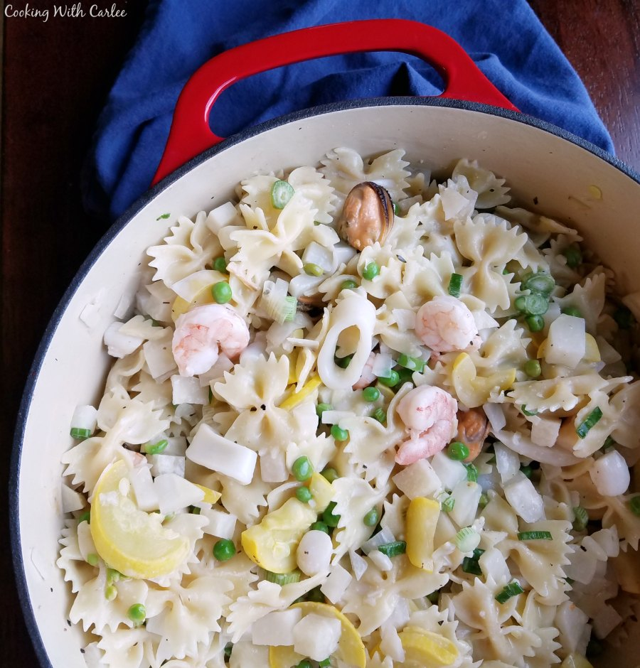 pan full of pasta, seafood and vegetables ready to serve.