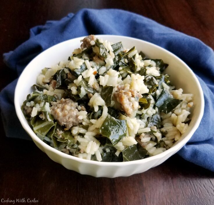 bowl of one pan collard greens with rice and sausage, ready to eat.