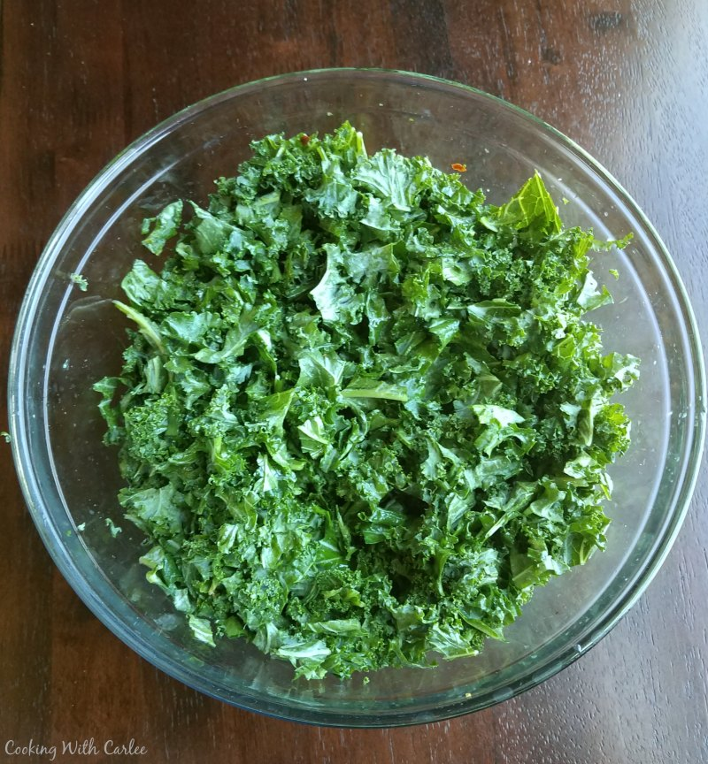 bowl of chopped, dressed and massaged kale.