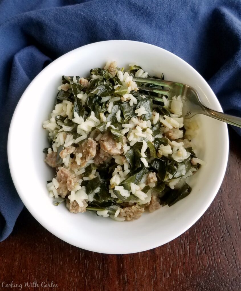 bowl of one pot collards with rice and sausage.