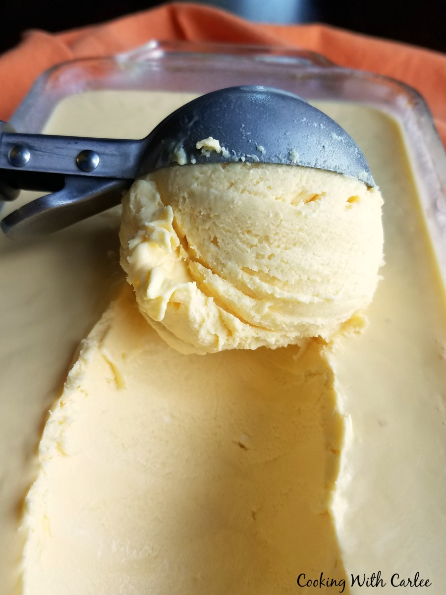scoop of ice cream being scooped out of loaf pan
