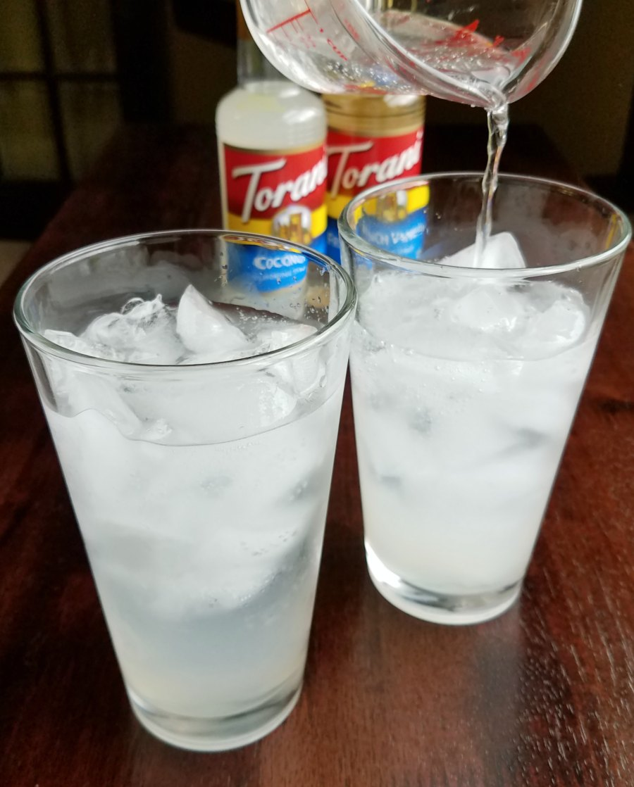 pouring soda water into glasses
