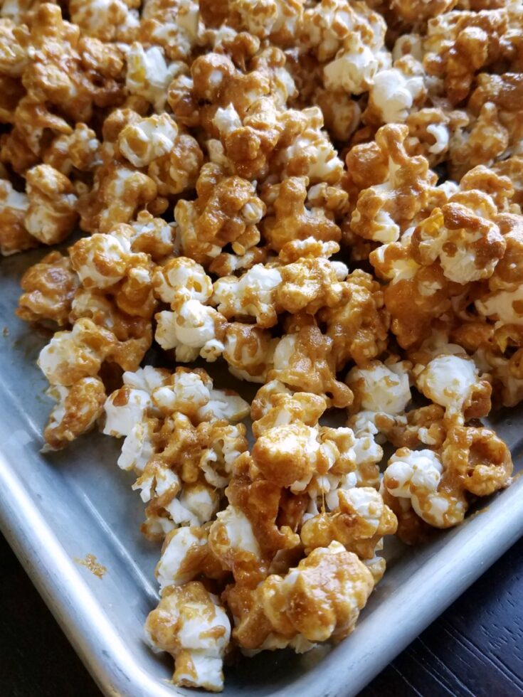 peanut butter popcorn cooling on tray.
