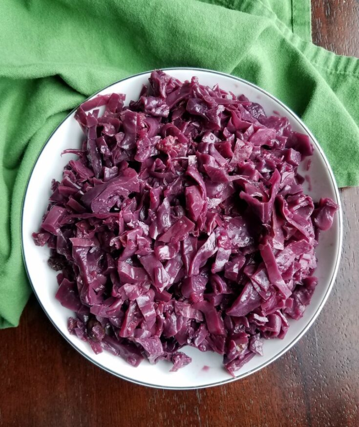 bowl of cooked red cabbage with apples