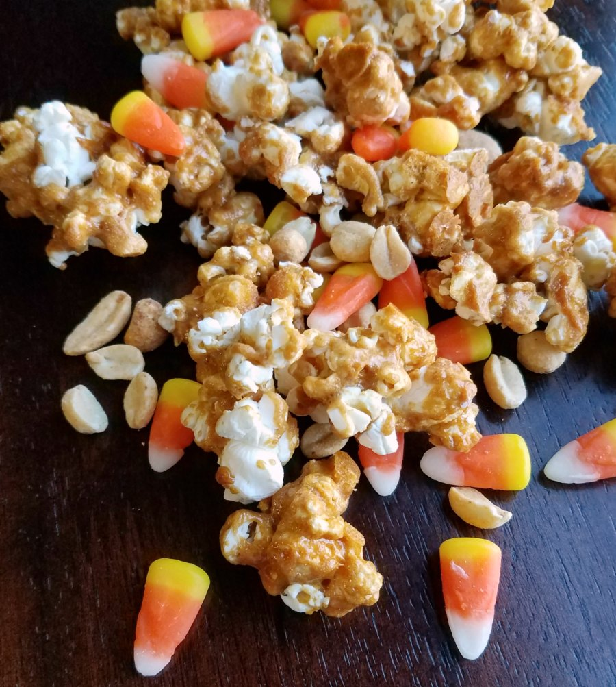 close up of hillbilly hash peanut butter popcorn with candy corn and peanuts.