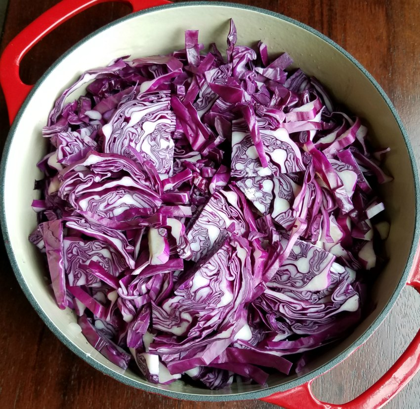 dutch oven full of sliced red cabbage