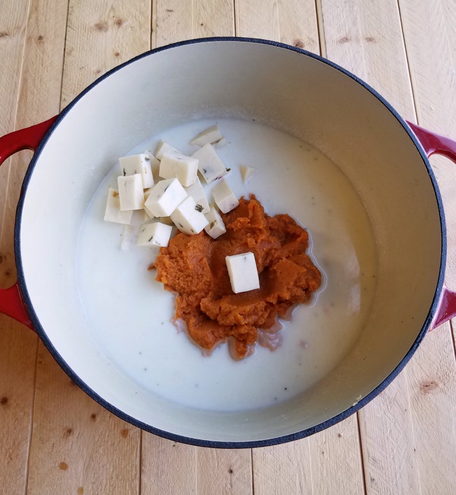 pumpkin, cheese and milk in large cast iron pot.