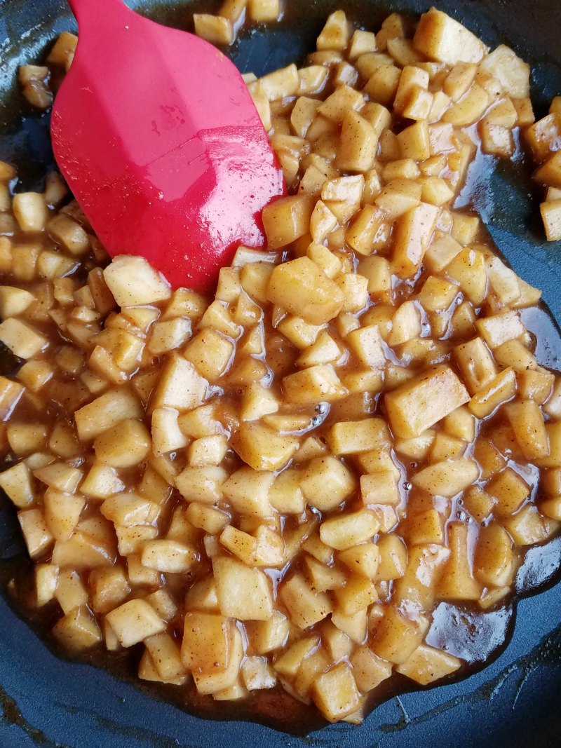 close up of caramelized apples in skillet