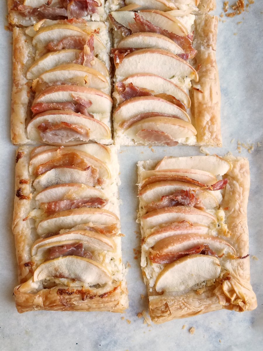 baked phyllo and ricotta tart with layers of apple and prosciutto alternating over the top