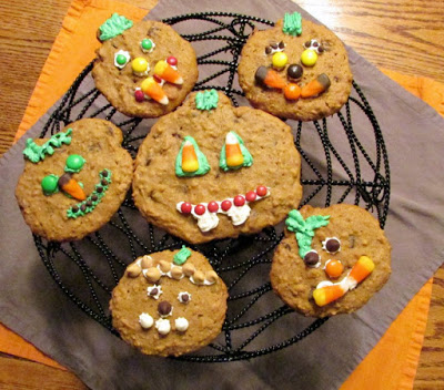 jack-o-lantern cookies on spider web tray