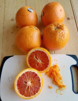 inside of blood orange halves with additional oranges in background