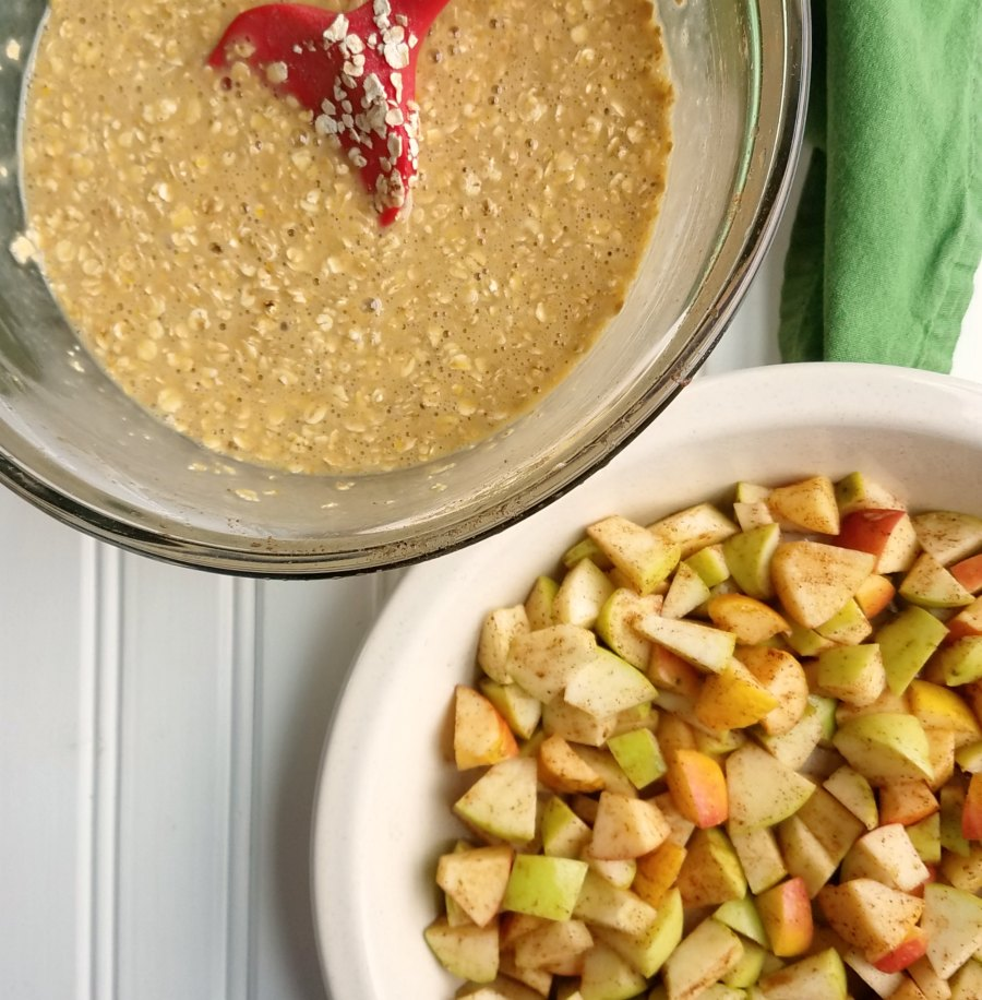 bowl of oatmeal mixture next to pie plate with apple chunks in it.