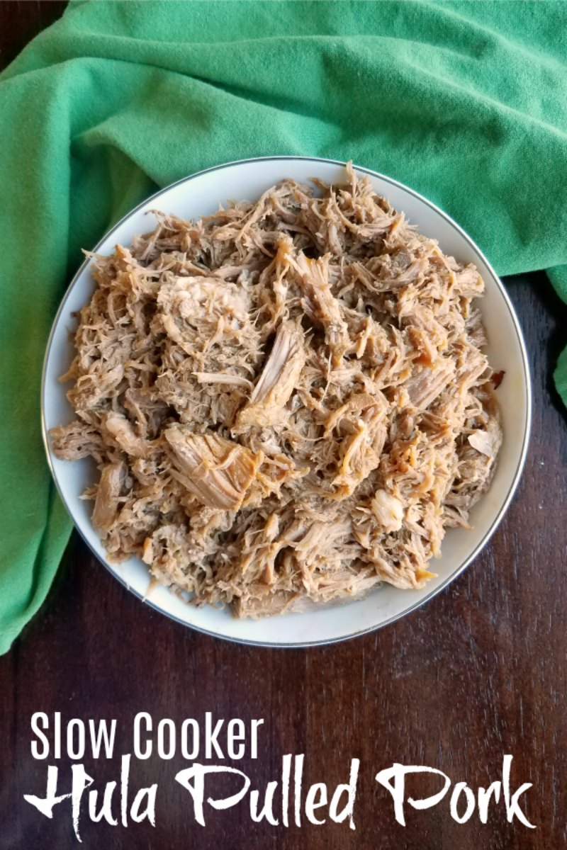 Bowl full of hula shredded pork with light sauce on it, ready to be eaten.