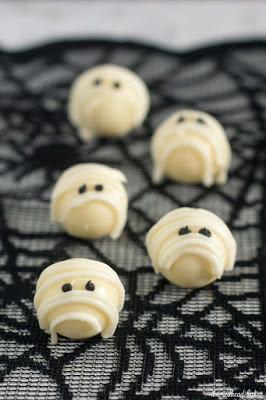 white chocolate truffles decorated like mummies