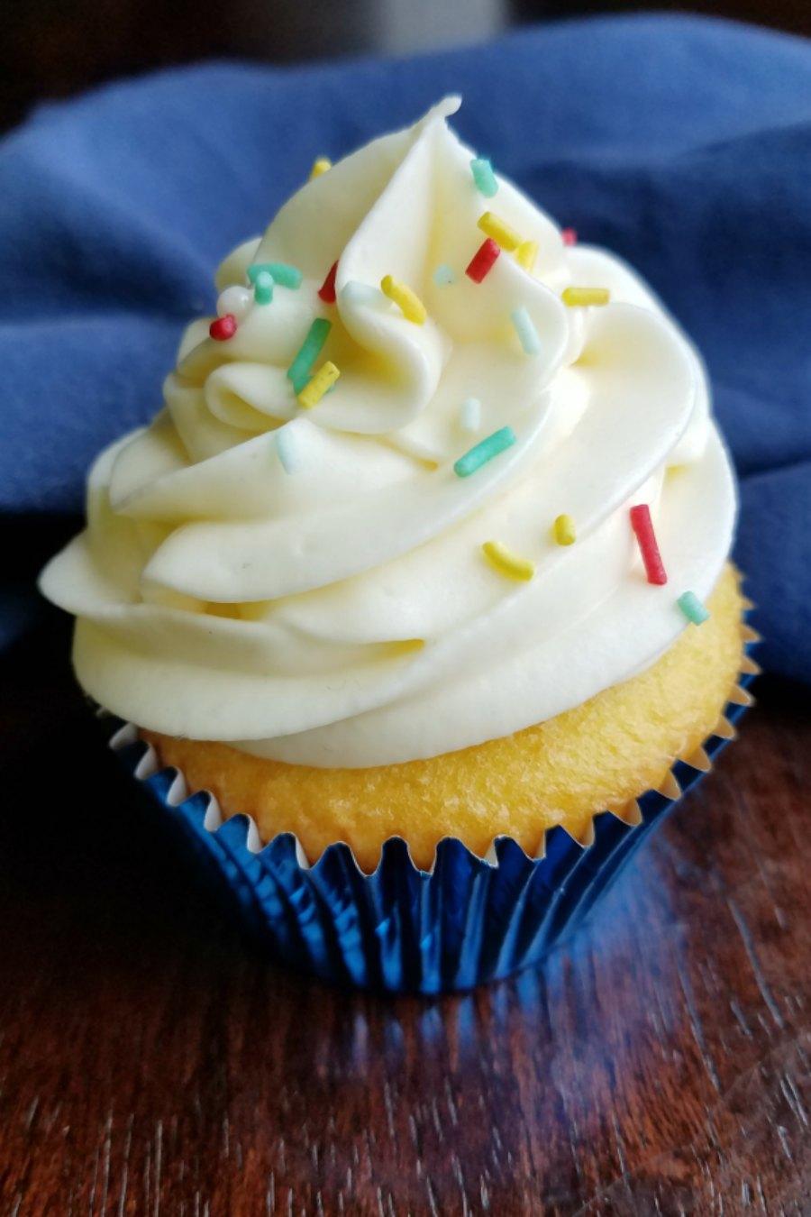 tall puffy swirl of lemonade frosting on cupcake